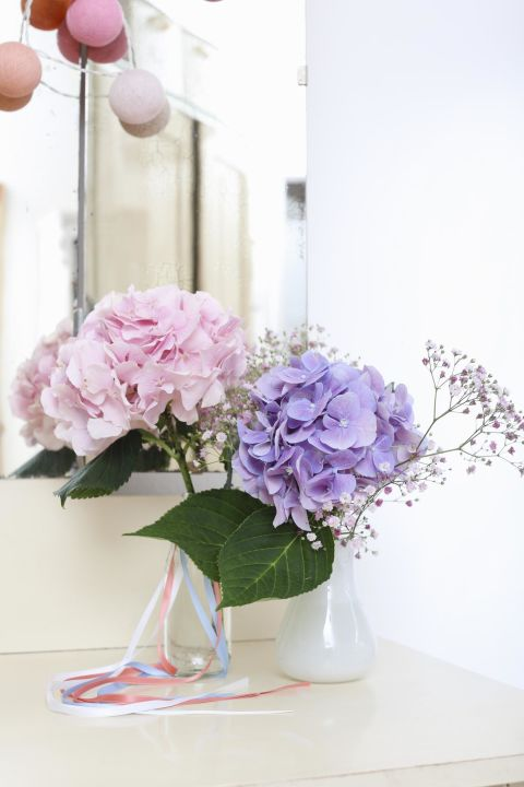 A jolt of hot water will wake them right up. Just boil water and pour it into a cup or any container. Then, cut the hydrangea stems to the desired length and stand them in the hot water for 30 seconds. Immediately after, put them in a vase with room temperature water. Tah-dah!<br />See more at Hydrangeas Hydrangeas »<br />