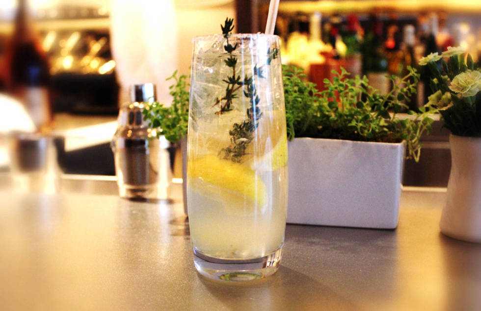 Jean-Georges' hard lemonade. This refreshing spiked lemonade comes from Chef Jean-Georges Vongerichten. 3 lemon wedges sugar .25 cup Lemon-Thyme Syrup.25 cup citrus vodka .25 cup club soda1 sprig fresh thyme, preferably lemon thyme Run 1 lemon wedge over the rim of a highball glass; dip the rim into sugar. Reserve the lemon wedge. Put the remaining 2 lemon wedges in a cocktail shaker along with the syrup and vodka. Muddle hard, breaking the lemon skins to release their oils. Cover and shake.Carefully fill the rimmed glass with ice. Pour the syrup mixture into the glass, lemon wedges and all. Top off with the club soda, the squeeze the reserved lemon wedge over before dropping it into the glass. Garnish with the thyme sprig and serve immediately. Lemon-Thyme SyrupMakes 1 cup.75 cup sugar1 small bunch fresh thyme, preferably lemon thyme (.5 ounce)In a small saucepan, heat 1 cup water and the sugar to boiling, stirring to dissolve the sugar. Add the thyme, remove from the heat, and let stand until cool. Strain through a fine-mesh sieve, pressing to extract as much liquid as possible. Cover and refrigerate for up to 3 days.